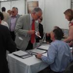 Patrick Francis signing copies of his book Vivat Shirburnia